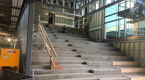 The learning stairs have been poured all the way to the top and are the forms being removed.