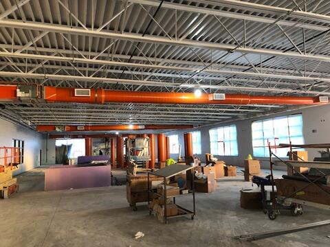Unit M (weight room) mechanical ductwork and receptionist station.