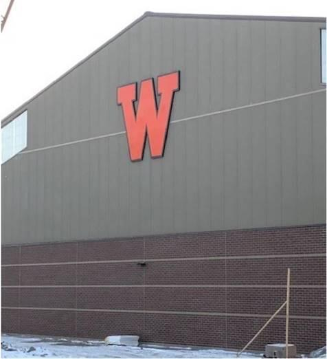 """The """"W"""" sign installed on athletic facility."""