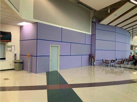 Dust/sound wall installed in commons for auditorium deconstruction.