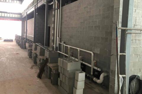 The final wall masonry at the large bathrooms near the cafeteria and gym is getting started.