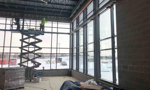 The glass is installed in the fitness room curtainwall.  With this in place, the building is now fully enclosed with either permanent glass or temp enclosures and is being heated.