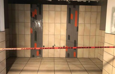 The tile in the main bathrooms on the second floor is complete with grout.  The danger tape is up to keep people off the tile to allow the grout to cure.