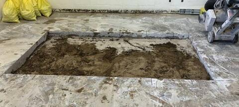 Unit E concrete saw-cut and removal (plumbing undergrounds).