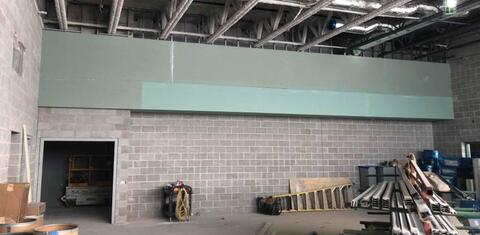 The soffit in the band room is drywalled and ready to be taped and finished.  Under this soffit will be different sized cubbies for storing musical instruments.