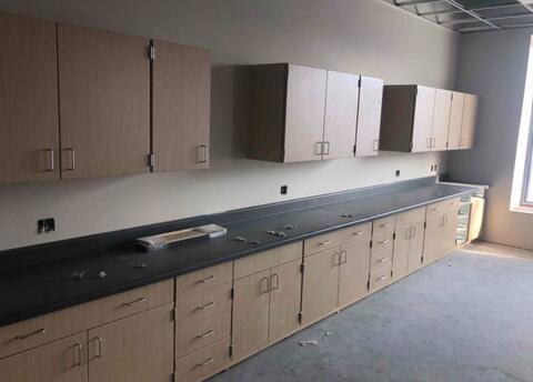 The cabinets and countertops are being installed in the science rooms on the second floor.  When complete, this countertop will have three separate sinks in it.