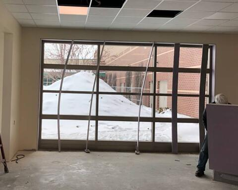 Aluminum Store Front installed Unit M and door jamb finishes being installed.