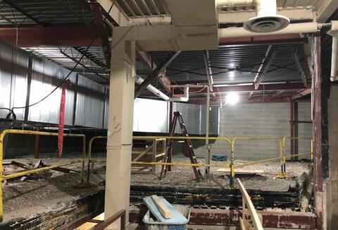 Auditorium wall demolition.