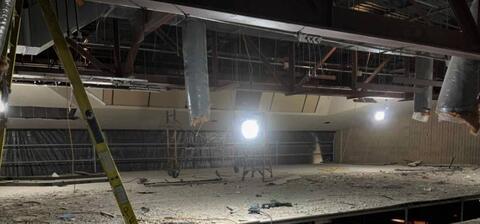 Auditorium plaster ceiling demolition.