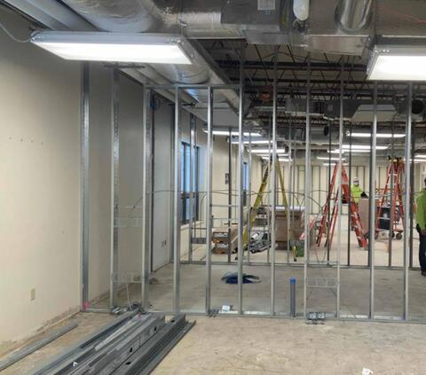 Area E (Biology) walls and MEP rough-in installation.