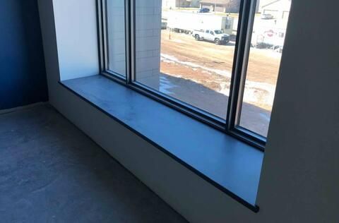 The solid surface window sills are being installed at the second floor window bump outs.  These will offer student a nice place to sit during the day.