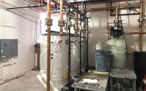 The water heaters are in place in the mechanical area.