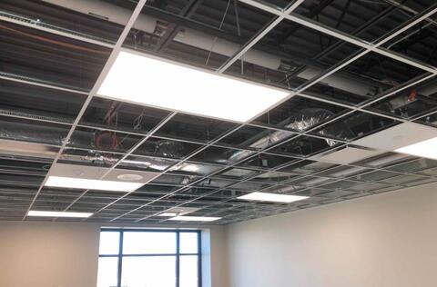 The lights in the second floor classrooms are installed and operating.  Starting next week the rest of the ceiling tiles will be dropped into place.