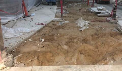 Auditorium – Concrete floor saw cut and demolition.