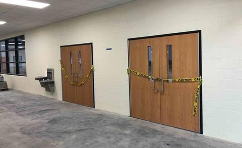 Area M – Wood door and hardware installation.