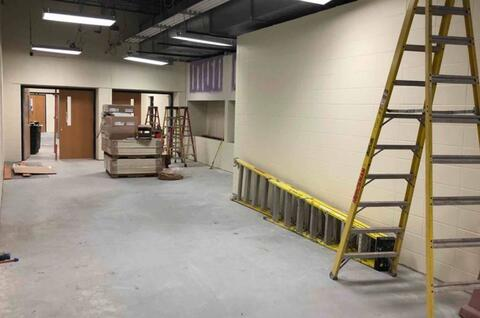 Area A – CMU walls paint and drywall tape/finish display case(s).