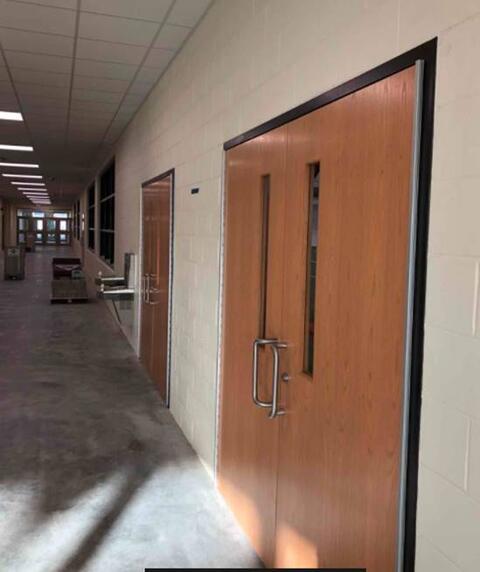 Area M – Glazing in wood doors installation.