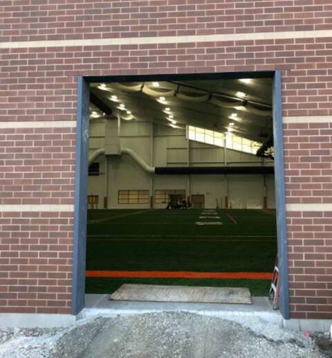 Athletic Field – Masonry and steel wrap at overhead door installation.