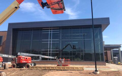 The trim is going in on the library curtain wall with only a few pieces to go.