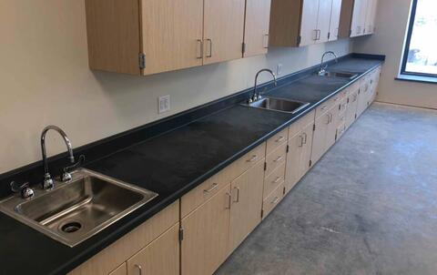 Sinks are installed in the science rooms.  Each science room has six sinks - three on each side.