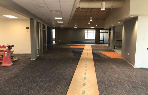 The flooring is being installed in the classrooms and hallways on the second floor.  Ceiling tiles have also been dropped into the ceiling grid.