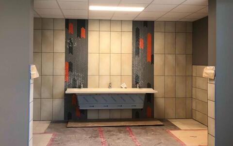Sinks and toilets are being installed in all the bathrooms in the classroom areas.  Pictured here is the sink located in the alcove between the boys and girls bathrooms.
