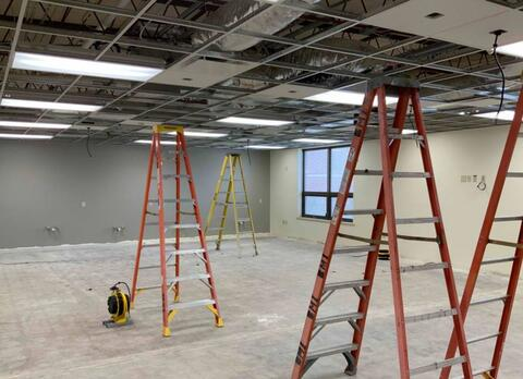 Unit E – Ceiling grid and tile installation.