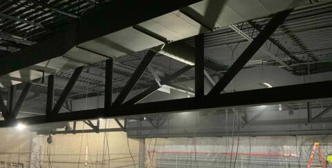Auditorium – Ceiling paint installation.