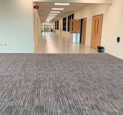 Area L –Lobby/Corridor flooring installation.