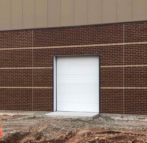 Athletic Field – Overhead door installation.