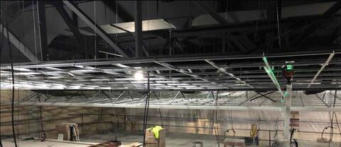 Auditorium – Acoustic ceiling grid installation.