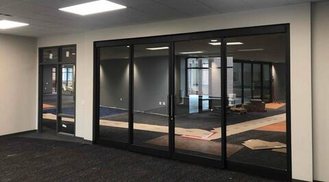 The sliding doors in the classrooms on the 2nd floor are in place.  These doors will have a frosted strip added through the middle.
