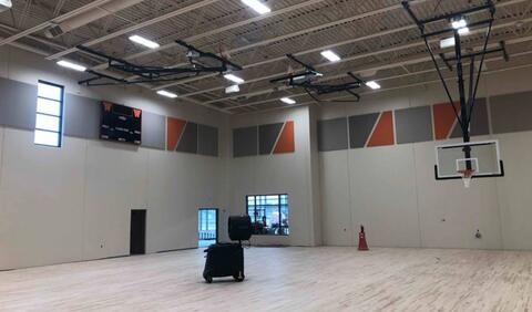 The wood floor in the gym is fully installed and the acoustical wall panels are up on the walls.  Next week, the floor will be sanded down and prepped for finishing and paint.
