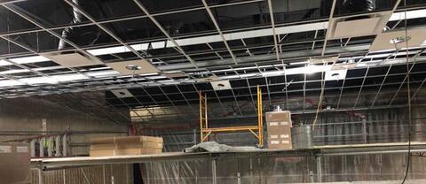 Auditorium – Acoustic ceiling grid installed.