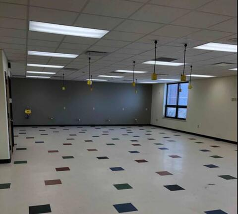 Area E – Flooring and wall base installed.
