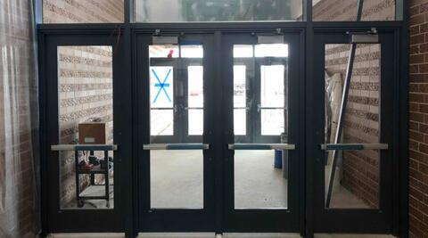 Exterior doors are being installed around the school.  Pictured here are the doors from the large east parking lot into the cafeteria.
