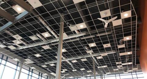 The ceiling grid, lights, and fans are in place in the library.  The ceiling tiles will be dropped into the grid next week.