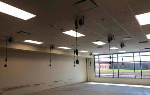 Chord reels are hung from the ceiling in the art room.  On Monday, this room will have the epoxy flooring installed.