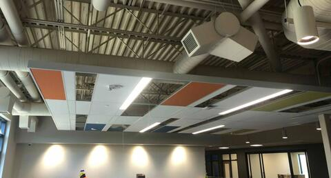 The ceiling tiles in the clouds above the lockers are going in.