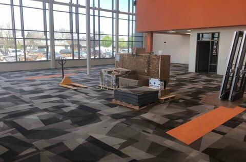 The carpet is installed in the library.
