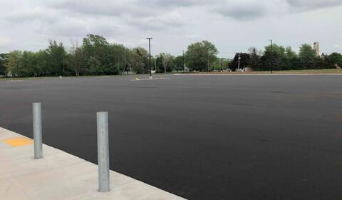 The asphalt is complete in the east parking lot and will have lines painted next week.