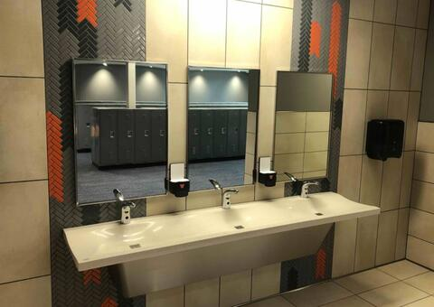 The toilet accessories are installed in the bathrooms.