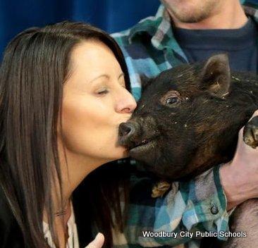 West End Memorial Principal Myers Kisses a Pig-02