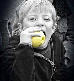 Student eating an apple