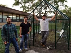 Home Depot crew building greenhouse