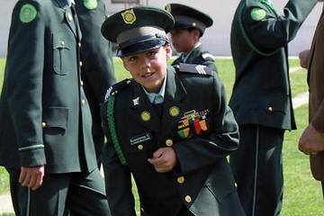 Boy wearing military uniform
