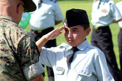 Boy doing salute sign