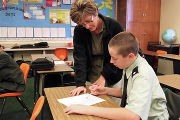 Woman teaching student