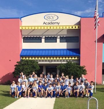 Students in front of SKY Academy building