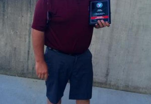 District Athletic Director Receives Award for Dedication to Athletics